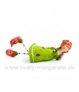 Dievčatko ležiace s obutými jahôdkami