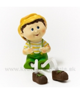 Chlapček Jožko s visiacími nohami zelený