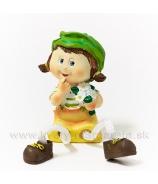 Dievčatko Dorotka s visiacími nohami zelená