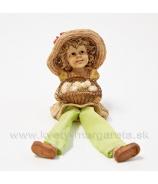 Dievčatko s košíkom vajec visiace nohy